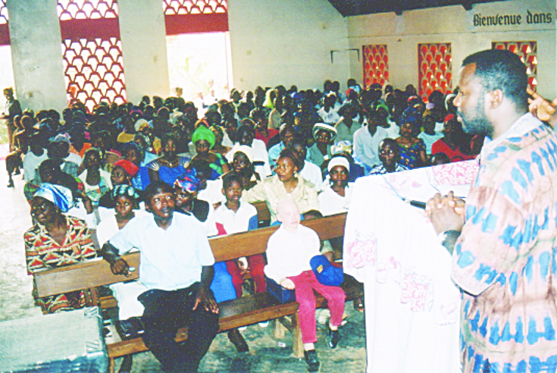 Ernest preaching at a crusade about 2001